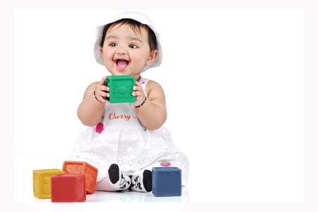 カラフルなブロックで遊んで赤ちゃん 写真素材