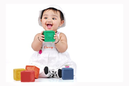 baby playing with colourful blocks