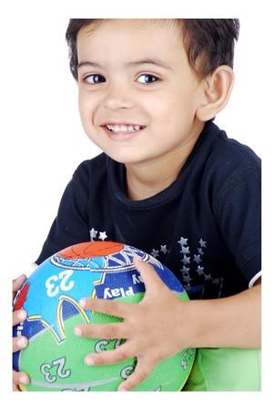 boy holding colourful basketball  Stock Photo