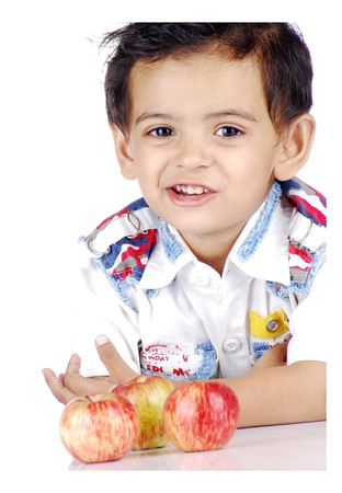 smart healthy boy counting apples  photo