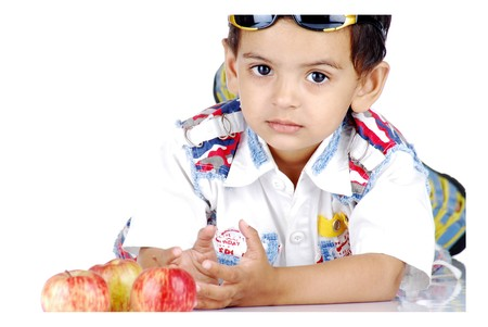 smart boy counting apples photo
