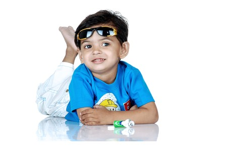 mischevious: boy wearing sunglasses on head in relaxing mood  Stock Photo