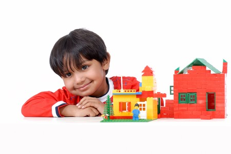 smiling boy with block houses