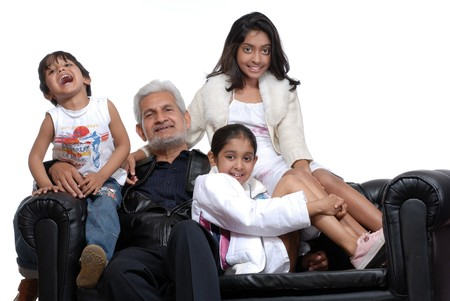 family on couch: Grand children with grand father