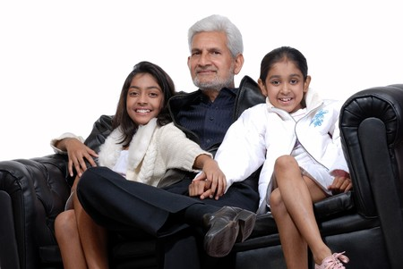 two young grand daughters sitting with grand father photo