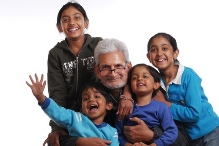 cheerful grand children with grand father Stock Photo