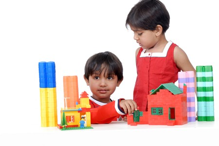 twins brother and sister playing with colorful blocks Stock Photo - 4544522