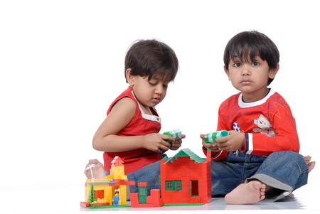 brother and sister playing together with blocks  Standard-Bild