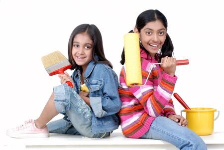 india woman: Two sisters ready to paint walls