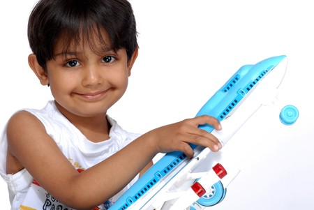 boy holding plastic toy Standard-Bild