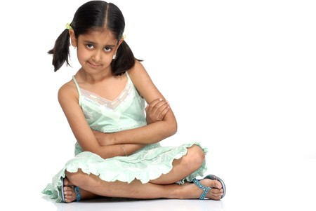 cute girl sitting over white background Standard-Bild