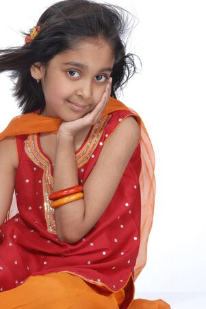 indian style sitting: beautiful girl in traditional dress  Stock Photo