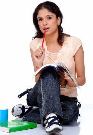 beautiful indian girl face: college student studying with coffee mug  Stock Photo