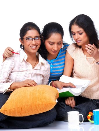 group of three college student studying together  photo