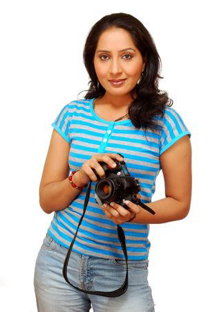 beginner: beautiful girl holding slr camera