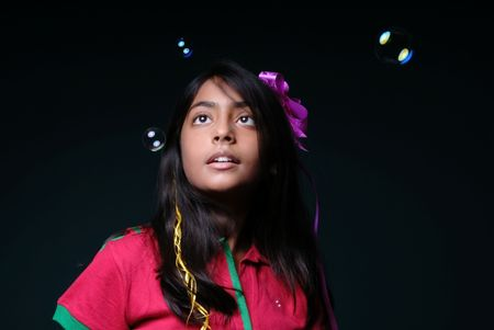 fashionable girl surrounded with soap bubbles  photo
