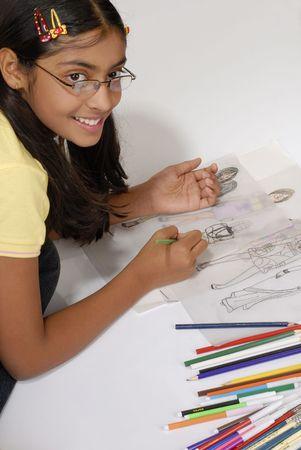 beautiful girl makes fashion sketch wearing specs  Banco de Imagens