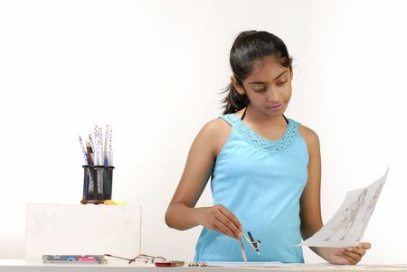 school table: girl making fashion sketch and draw circle with compass  Stock Photo