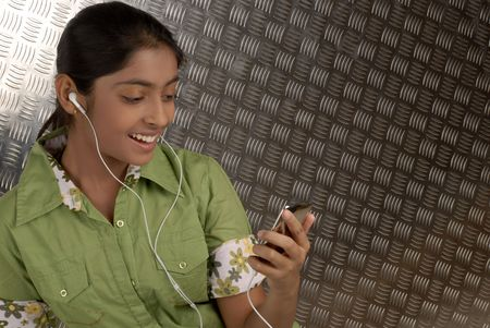 portable mp3 player: beautiful girl listening music on her portable mp3 player