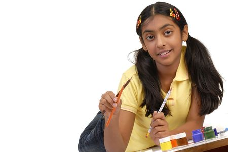 art activity: beautiful school girl holding pencil and color