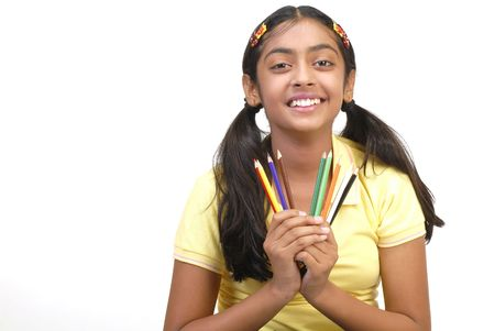 assignments: beautiful school girl looking in camera holding nine color pencil