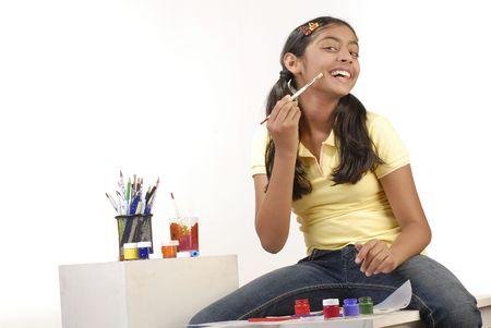 beautiful school girl painting on her cheek