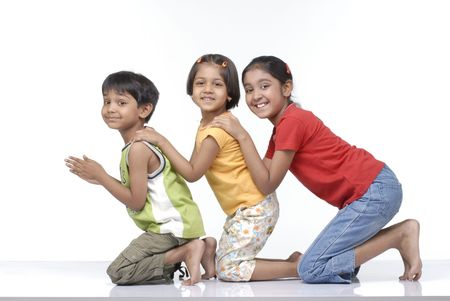 brother and two sisters enjoying together Standard-Bild