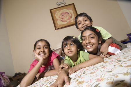 ranging: siblings ranging in age from eleven to four are having fun together