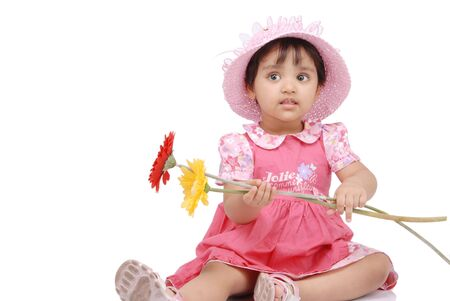 2-3 year old baby girl holding flowers Stock Photo - 5529070