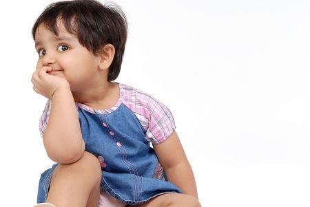 2-3 years old baby girl thinking over white background Standard-Bild