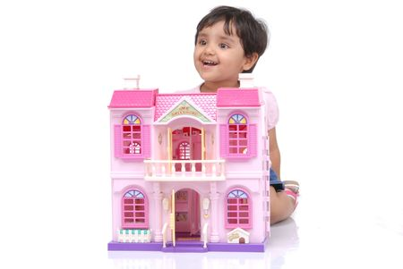 doll house: 2-3 years old baby girl playing with doll house  Stock Photo