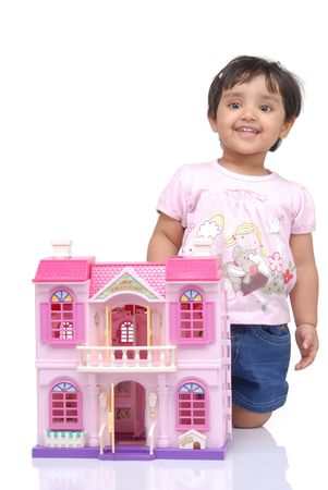 doll house: 2-3 years old baby girl with doll house over white background