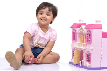 doll house: 2-3 years old baby girl sitting with doll house