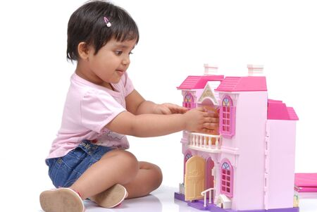 doll house: 2-3 years old baby girl opening the door of doll house