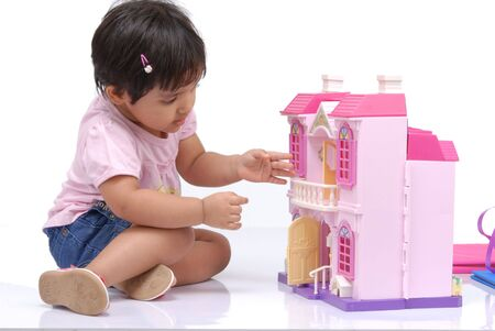 doll house: 2-3 years old baby girl observing doll house