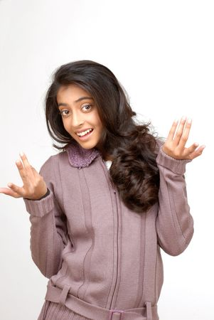 seeking an answer: indian teenager girl shrug her shoulder in wonder gesture  Stock Photo