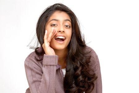 beautiful teenager girl whispering secrets into camera  Banco de Imagens