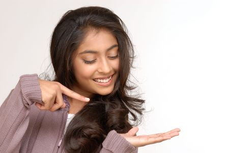 specifying: indian girl pointing for showing something  Stock Photo