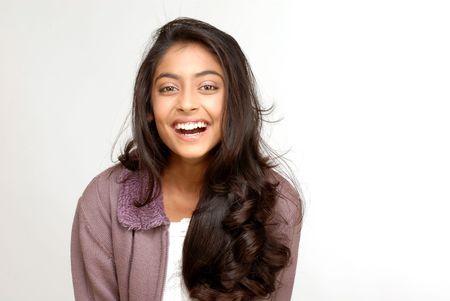 portrait of indian teenager smiling girl over white background Standard-Bild