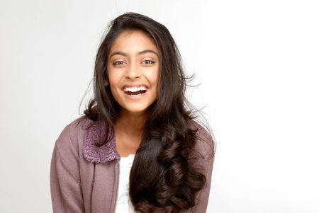beautiful indian girl face: portrait of indian teenager smiling girl over white background