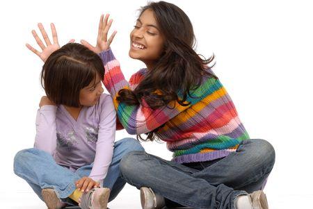 Two naughty indian girls having fun Standard-Bild