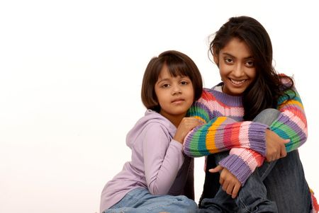 Two indian sisters sitting together  photo
