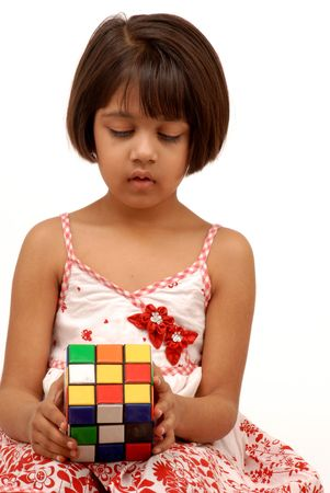 brain mysteries: indian little girl with rubic cube