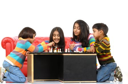 indian children playing board game at home  photo