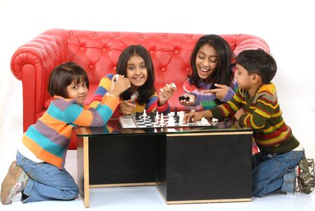 indian children playing board game at home Stock Photo - 6271314