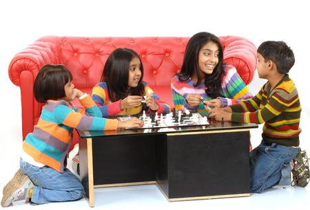 indian children playing board game at home
