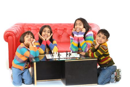 5 10 years old: indian children playing board game at home