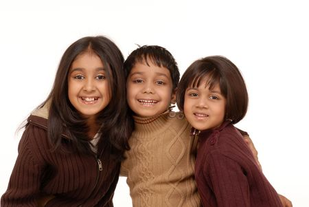 indian family: brother and sisters isolated on white background  Stock Photo