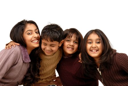 indian children: portrait of joyful brother and sisters