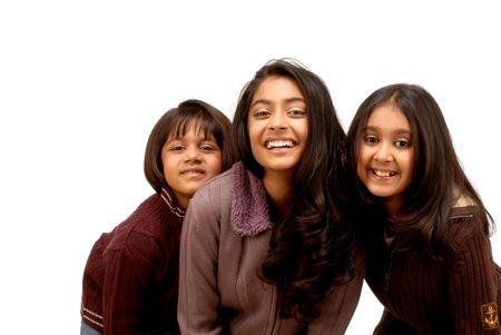 happy smiling sisters indoor